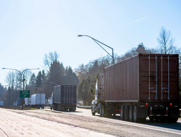 trucks exiting highway for weigh station