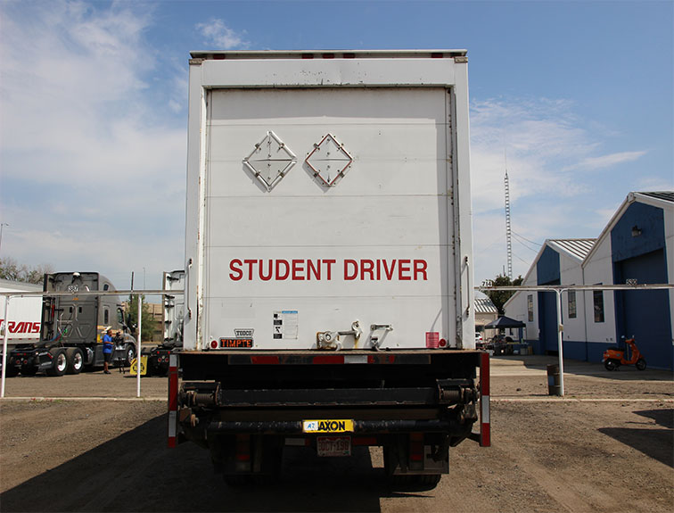 box truck with student driver labeled on back