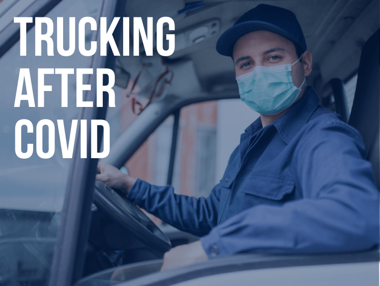 Man wearing mask while behind the wheel of a truck